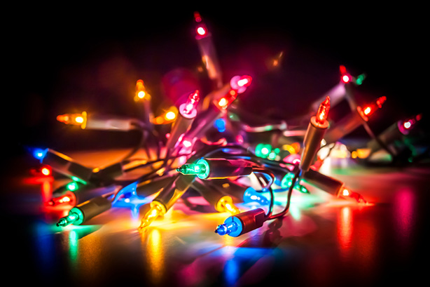 Christmas fairy lights isolated on reflecting surface.
